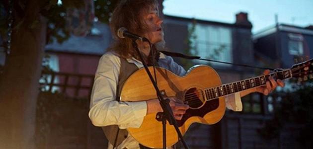George Frakes playing guitar